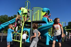 Image Caption: Image shows students playing on new playground at Hollydale Elementary