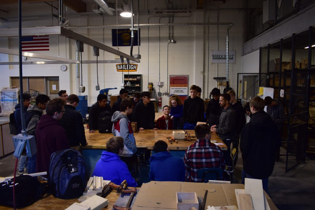 Photo shows Mr. Pikop teaching Barlow HS freshmen in the new woodshop, funded by the 2016 Gresham-Barlow School Bond.